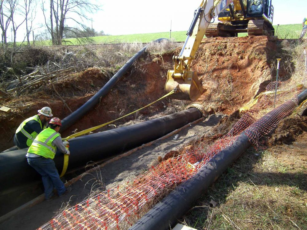 The HALL Contracting Corporation team working together on the Ash Outfall Slipline Project